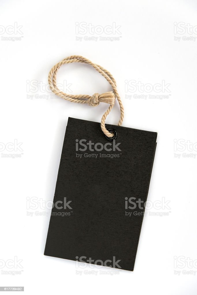 Blank label (tag) tied with stringon white background. stock photo