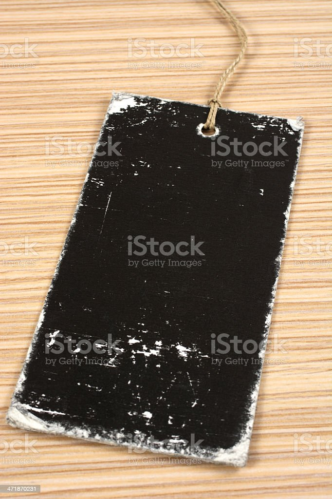 Blank label with string on table royalty-free stock photo