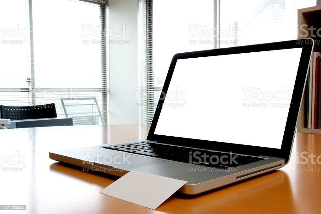 Blank laptop with blank business card inside of an office royalty-free stock photo