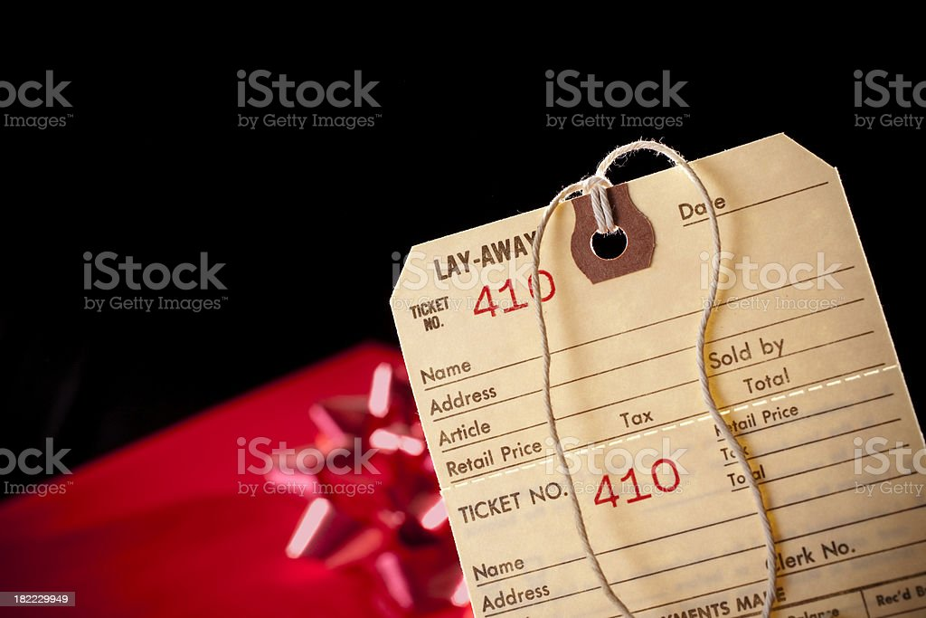 Blank, layaway label. Christmas gift in background royalty-free stock photo