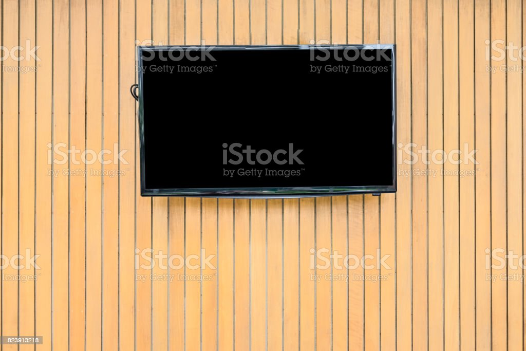Blank lcd Flat screen television hanging at the planks wooden wall stock photo