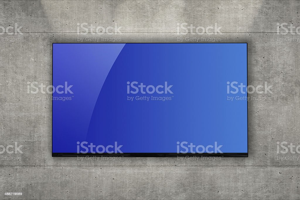 Blank LCD television mounted on a concrete wall stock photo