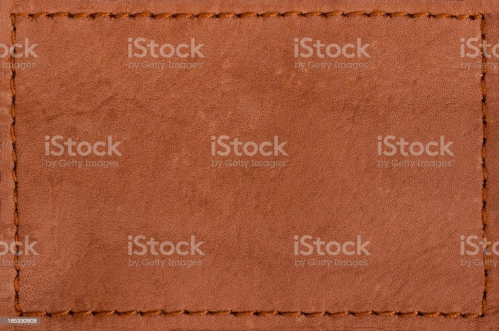 Blank leather jeans label isolated on white background stock photo