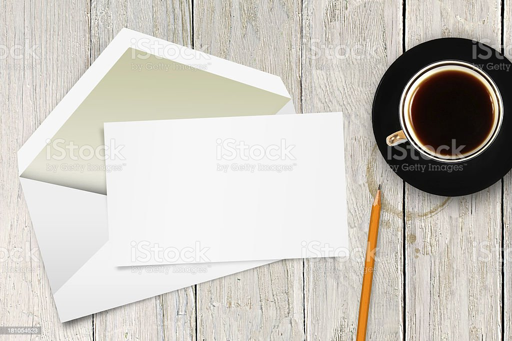 blank letter with envelope and coffee cup on the table stock photo