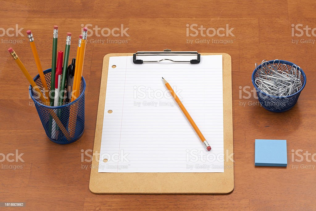 Blank Lined Paper, Clipboard, and Pencils on Desk royalty-free stock photo