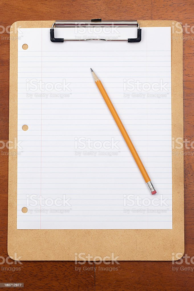 Blank Lined Paperand Pencil on a Clipboard royalty-free stock photo