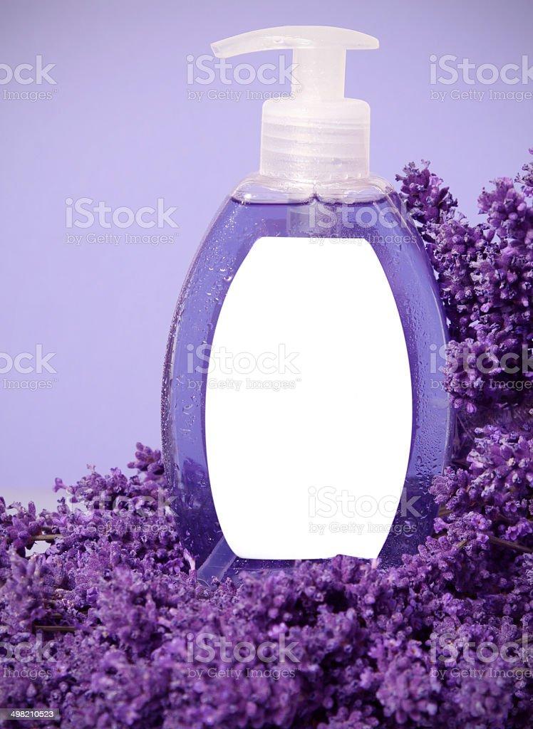 Blank liquid soap bottle on lavender flowers stock photo
