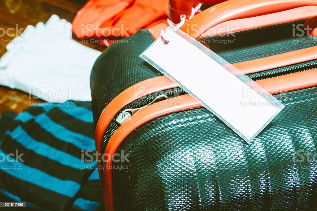 Blank luggage tag on suitcase stock photo