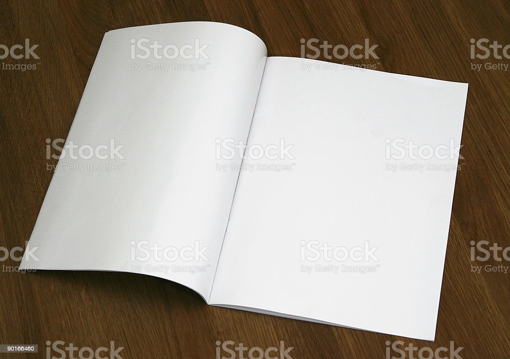 A blank magazine opened on a wooden surface stock photo