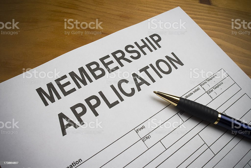 Blank membership application on desk with ballpoint pen stock photo