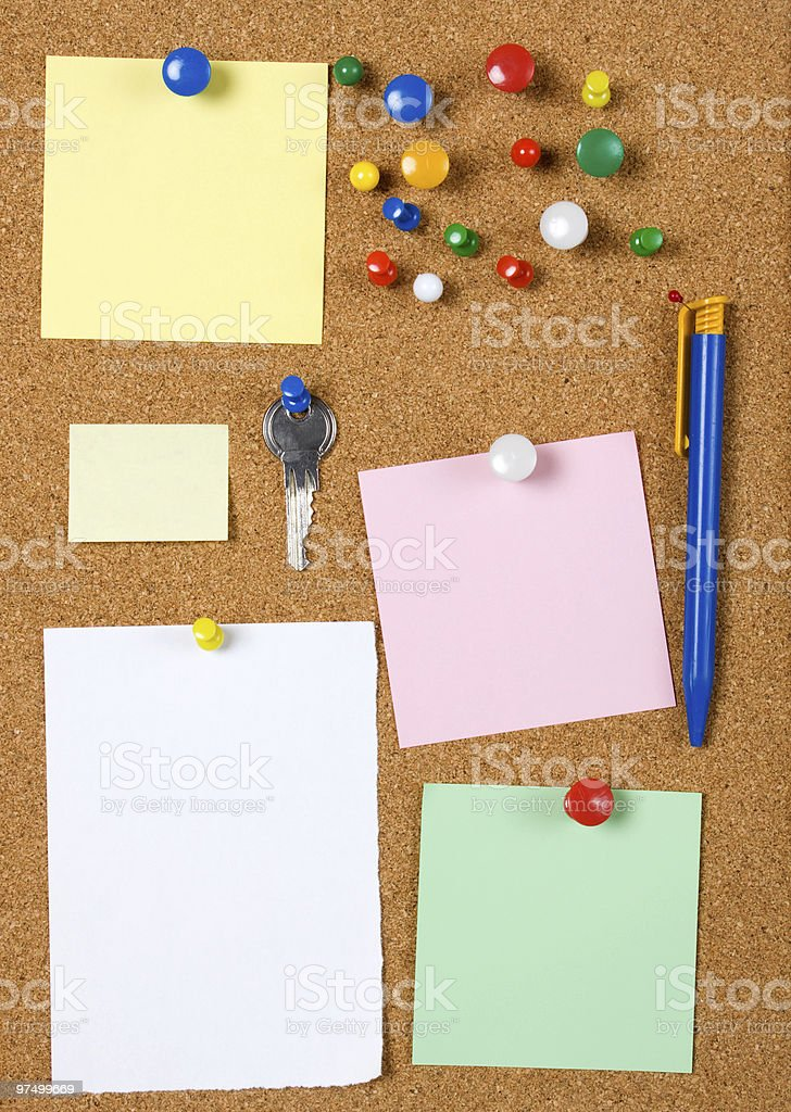 Blank memo notes on cork board royalty-free stock photo