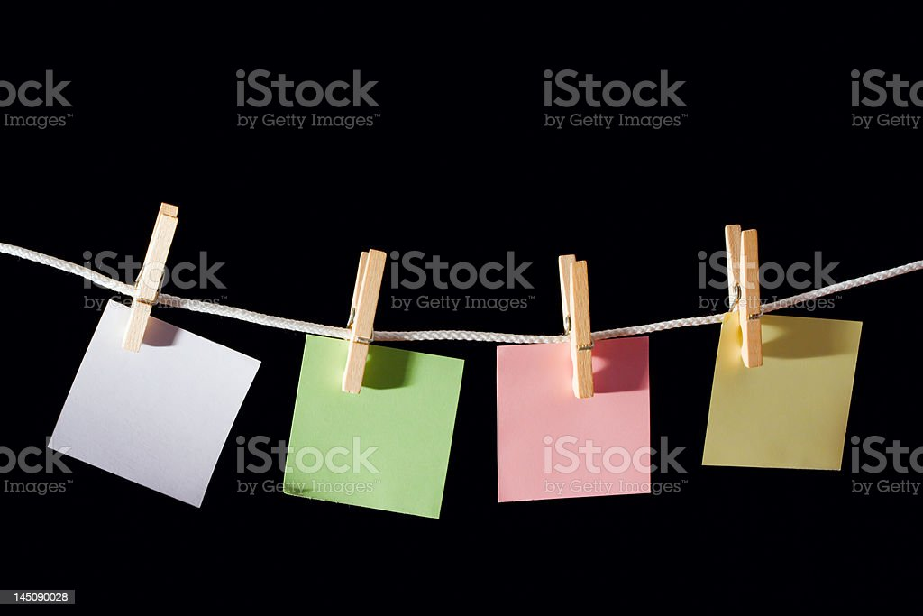 Blank memo Sheets of paper hanging on the rope royalty-free stock photo