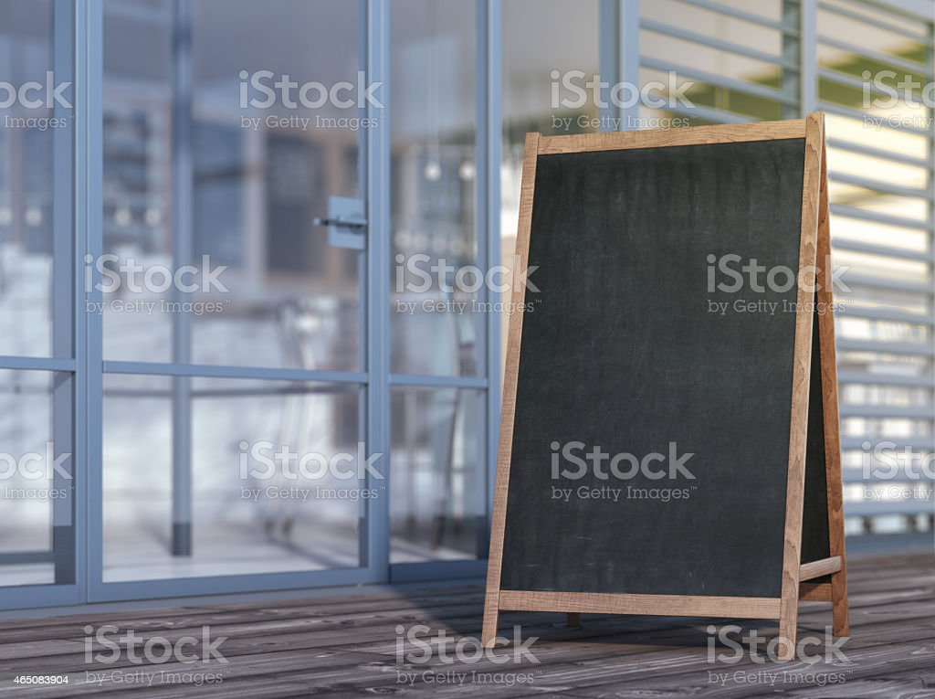 Blank menu board on sidewalk stock photo