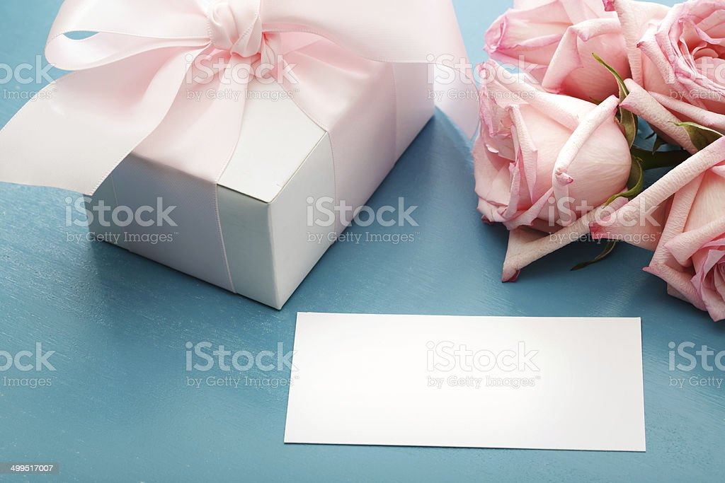 Blank message card with gift box and roses stock photo