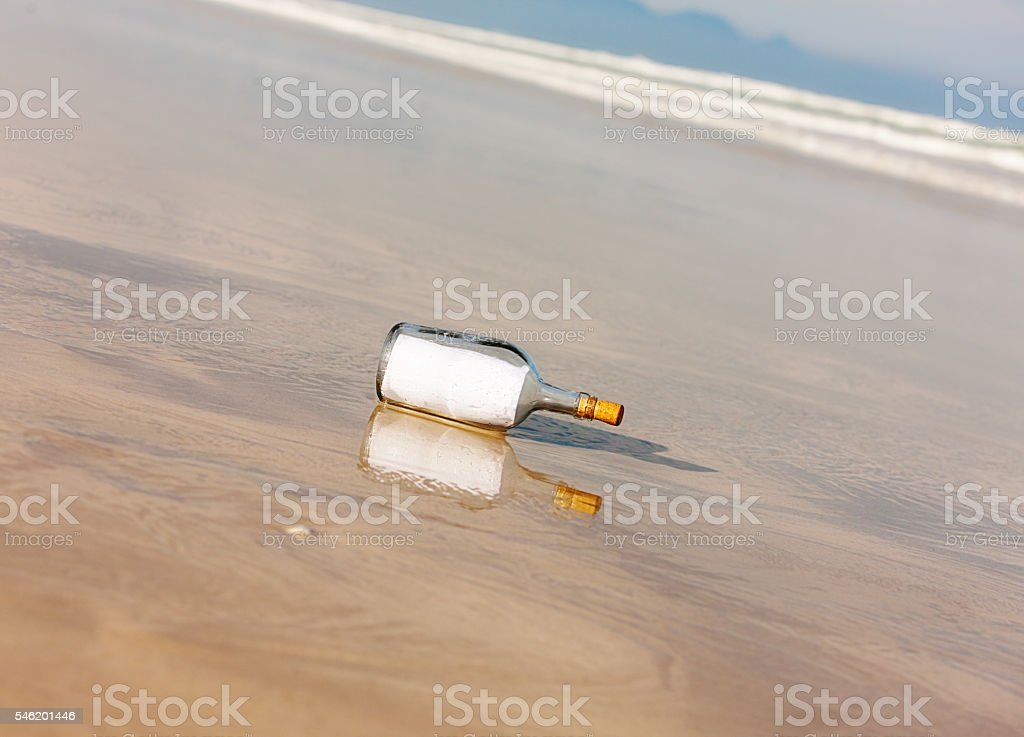 Blank message in a bottle on beach; you choose message stock photo