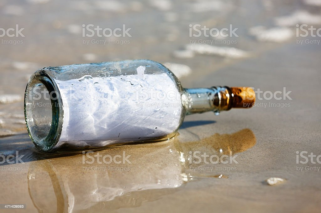 Blank message in bottle cast up on beach royalty-free stock photo