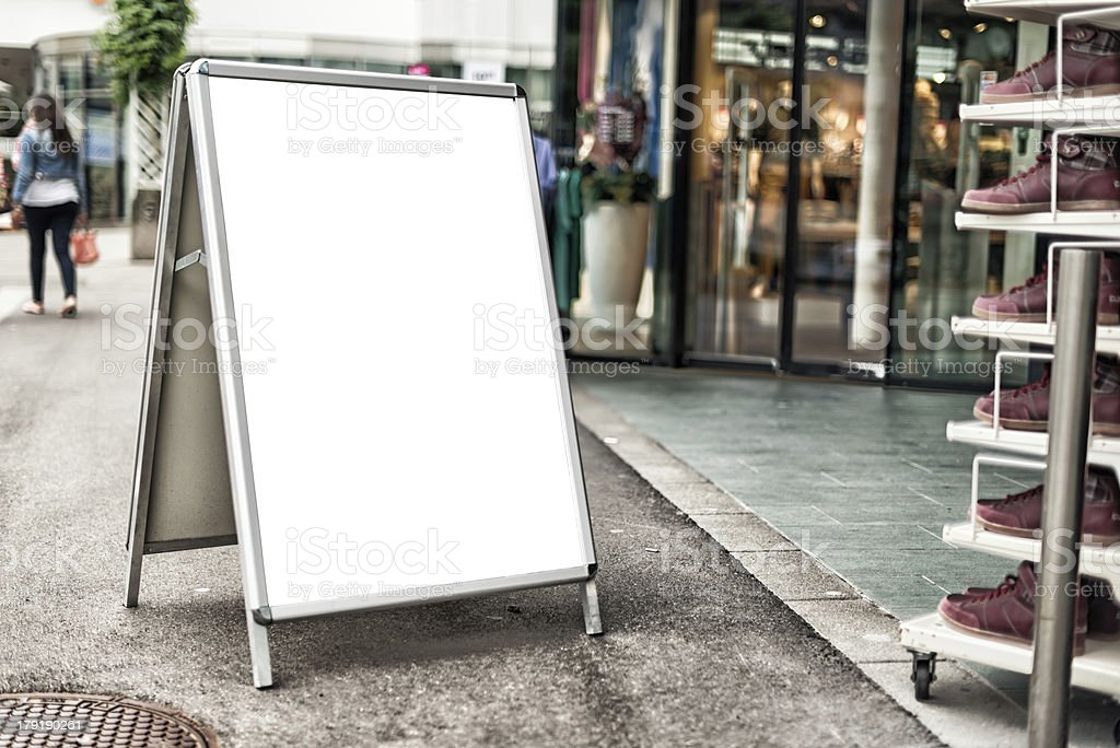 blank message store sign in front of shoe shop royalty-free stock photo