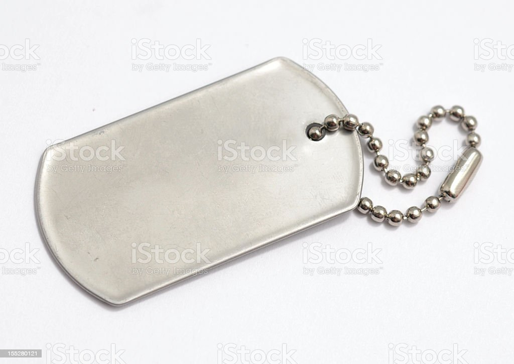 Blank, metal dog tag on white background stock photo