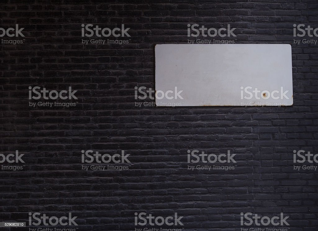 Blank metal plate on old brick wall background stock photo