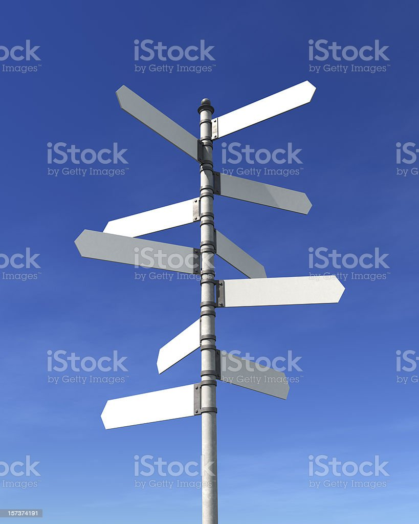 Blank multidirectional sign post stock photo