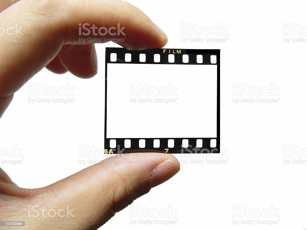 blank negative film in hand stock photo