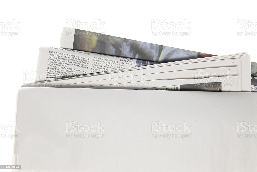 Blank newspaper set against a white background royalty-free stock photo