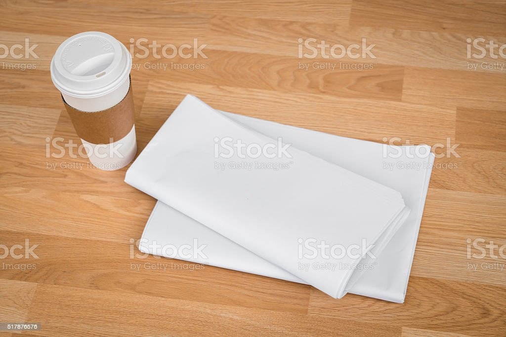 Blank Newspaper with empty space and coffee cup stock photo