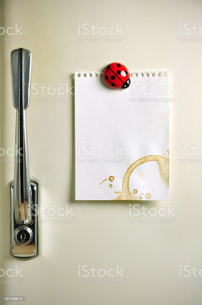 Blank note on fifties fridge door, copyspace for message stock photo