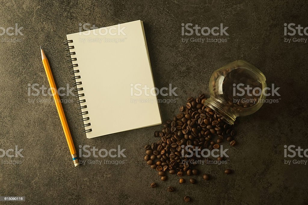 blank note paper, pencil and coffee beans stock photo