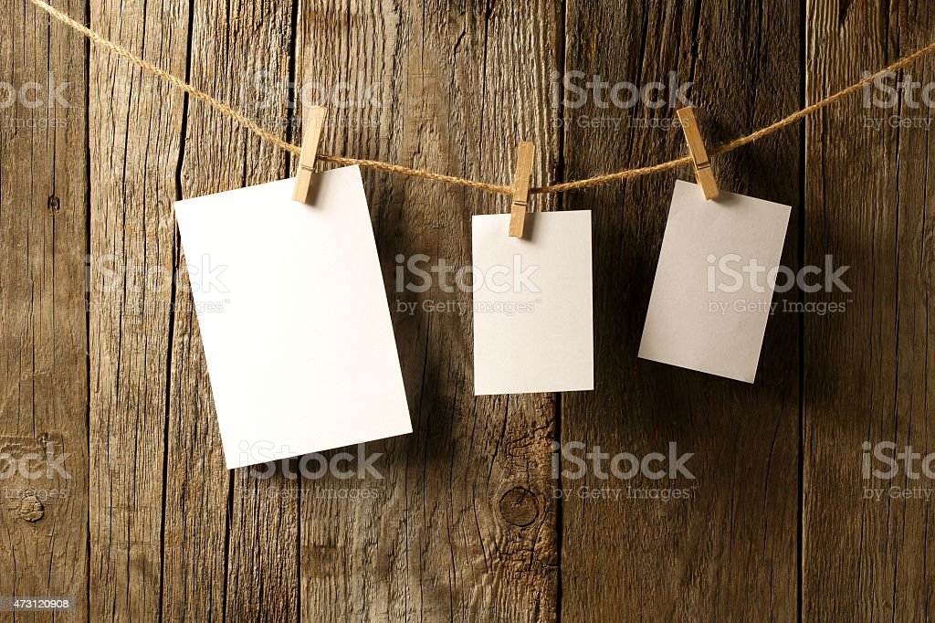 Blank note papers on wooden background stock photo