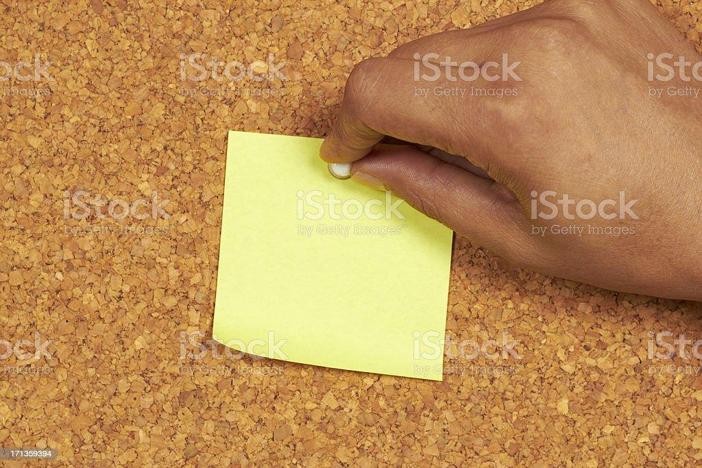 Blank note pinned to corkboard stock photo