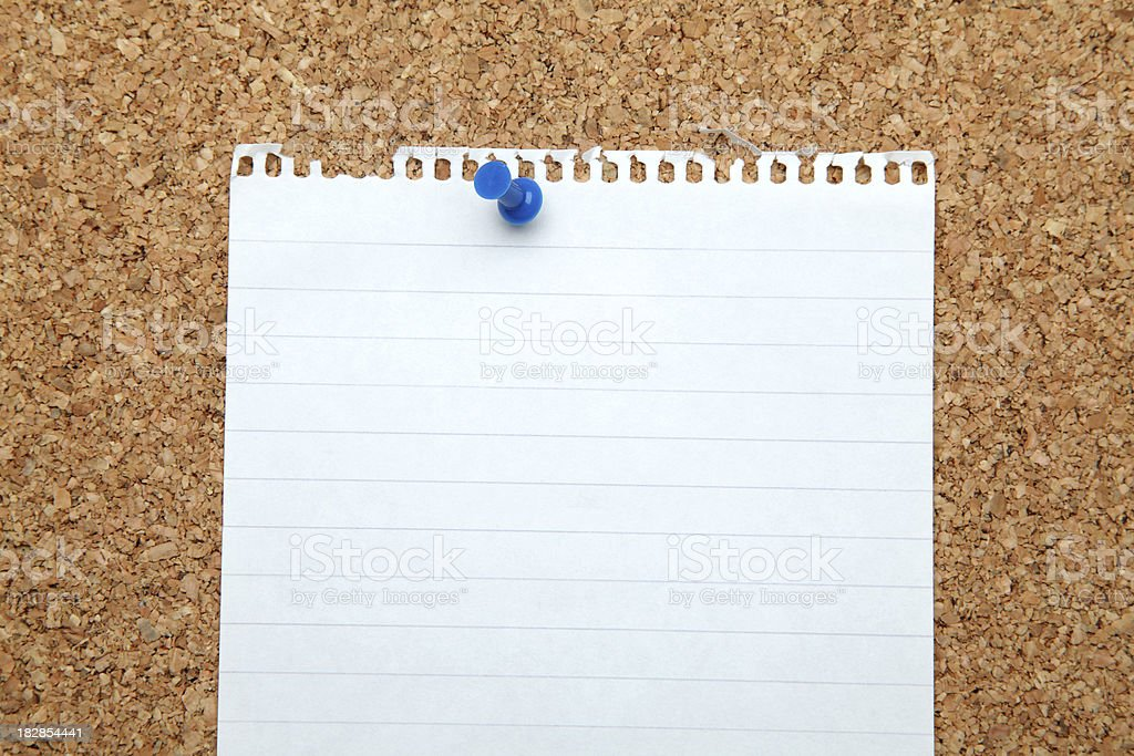 Blank note pinned to corkboard royalty-free stock photo