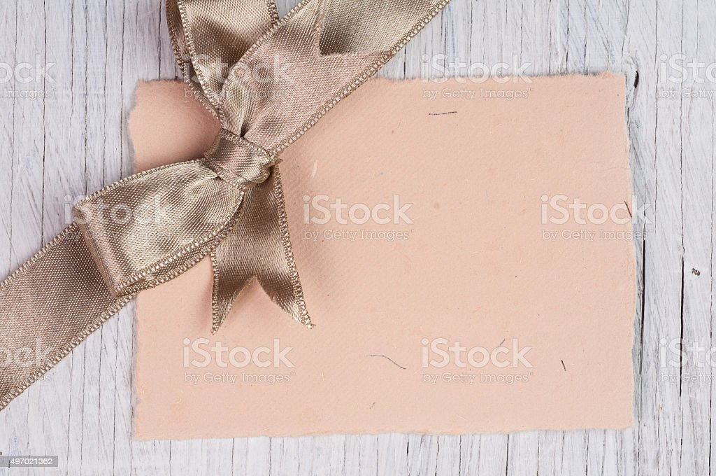 Blank note with bow decoration stock photo