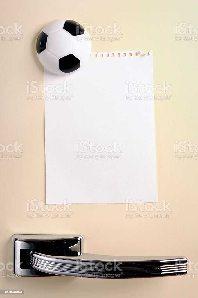 Blank note with football magnet on fifties fridge door stock photo
