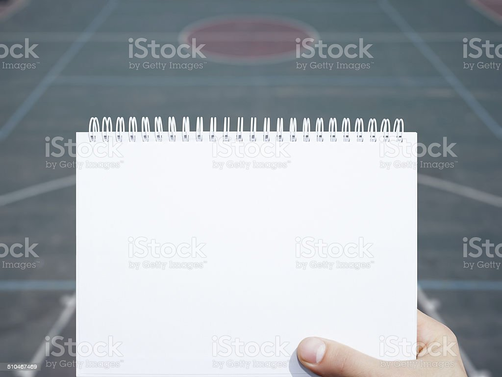blank notebook and basketball court background stock photo