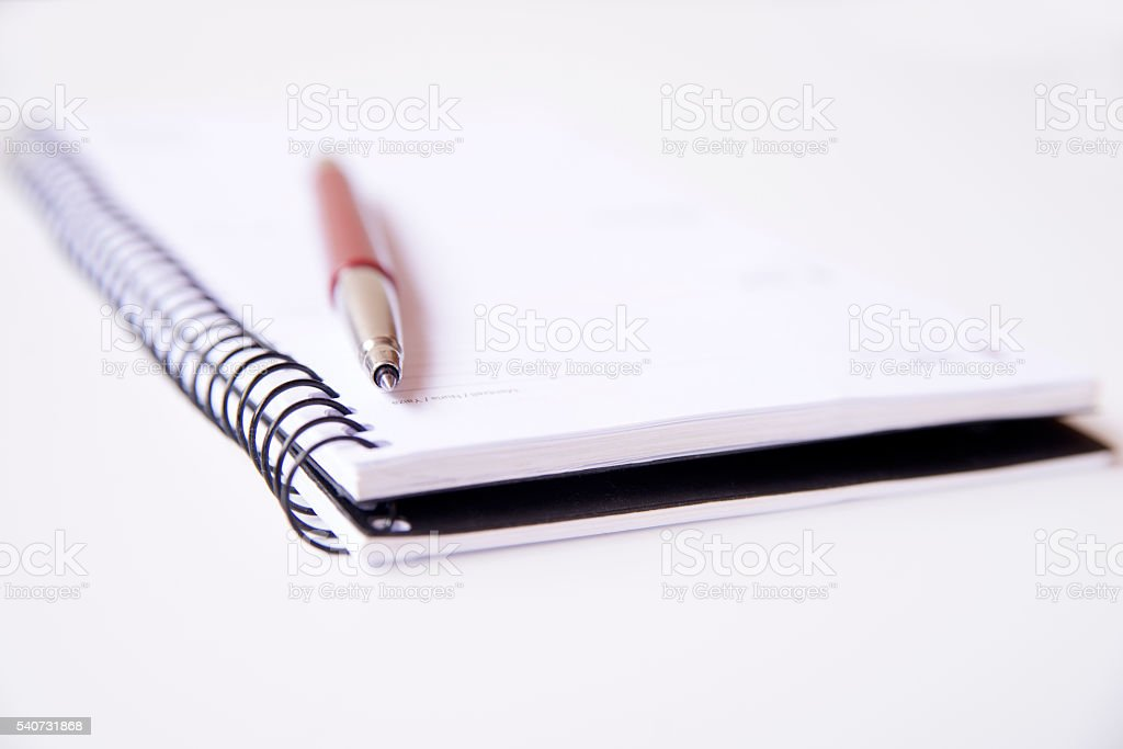 Blank notebook and red pen stock photo