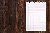 Blank notebook on a wooden background, copy space