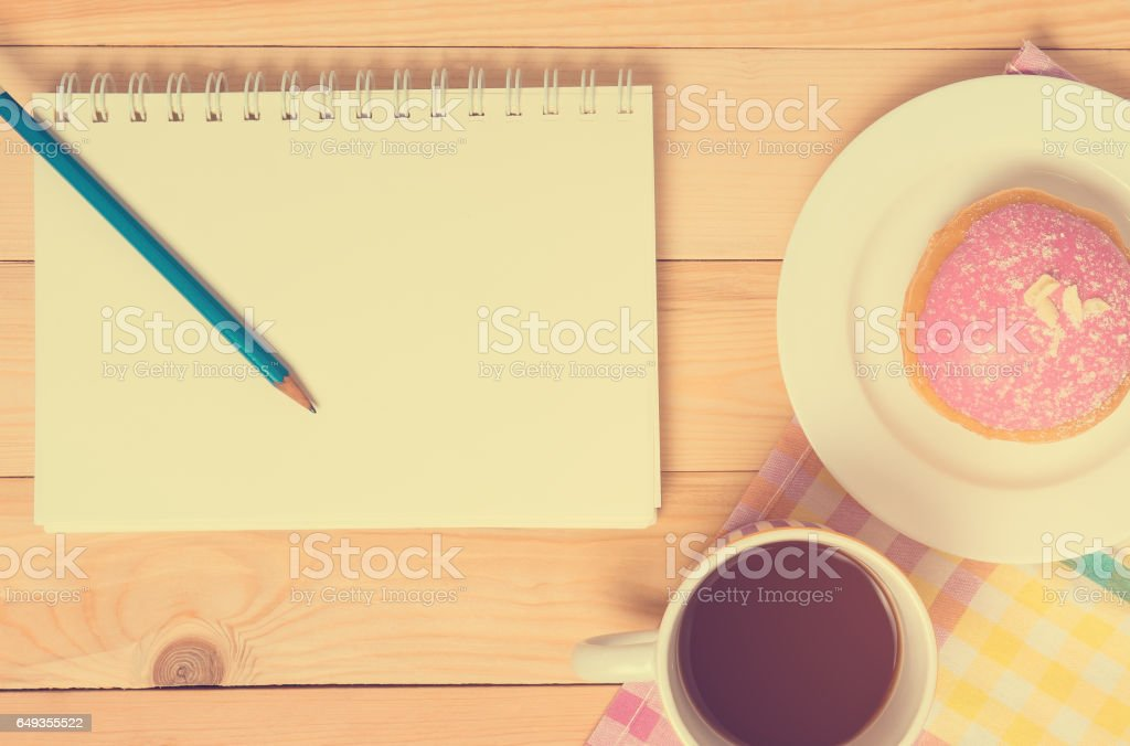 Blank notebook on breakfast cafe table stock photo