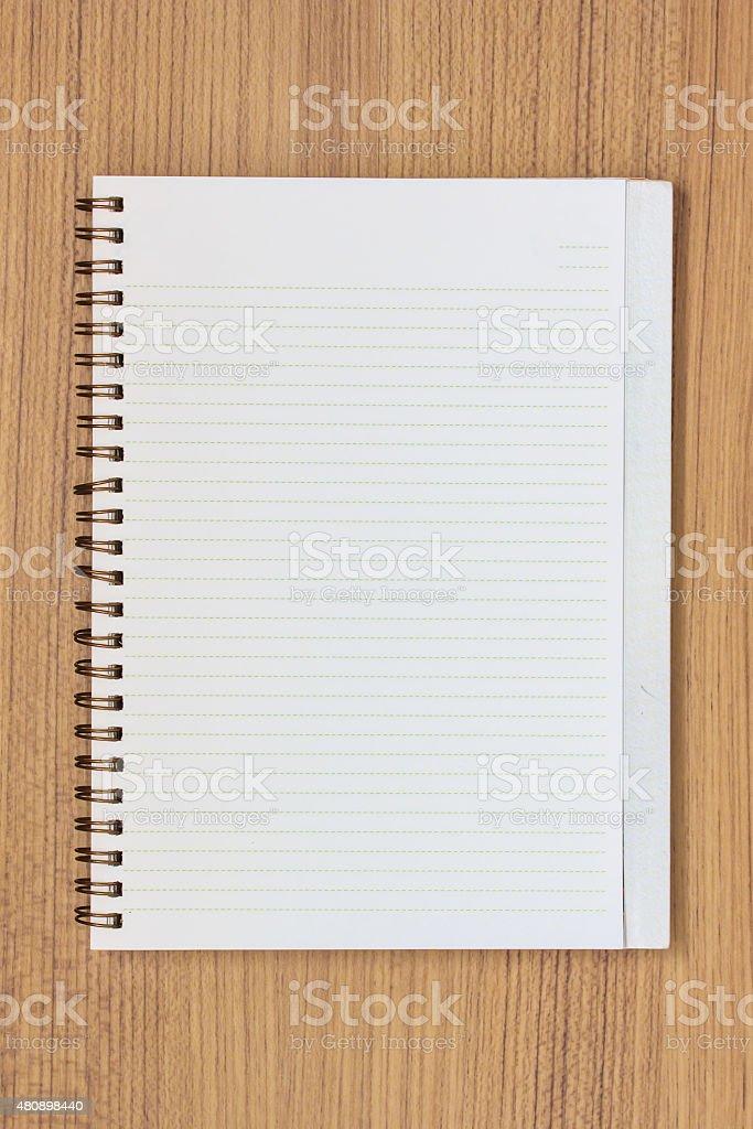 Blank Notebook on Grunge Wood. stock photo