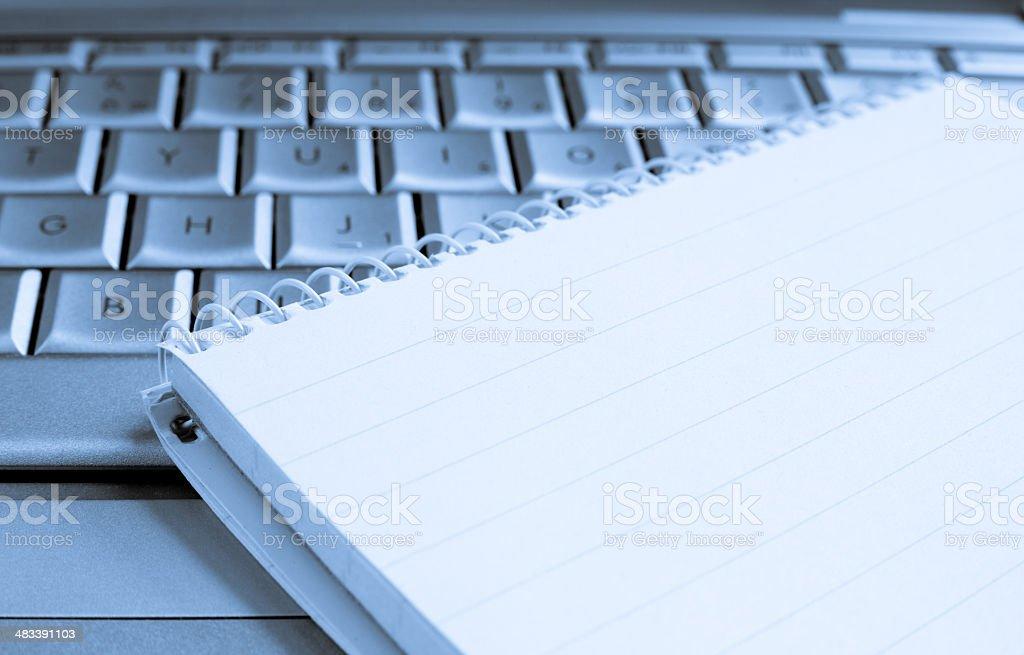 Blank notebook on Laptop stock photo