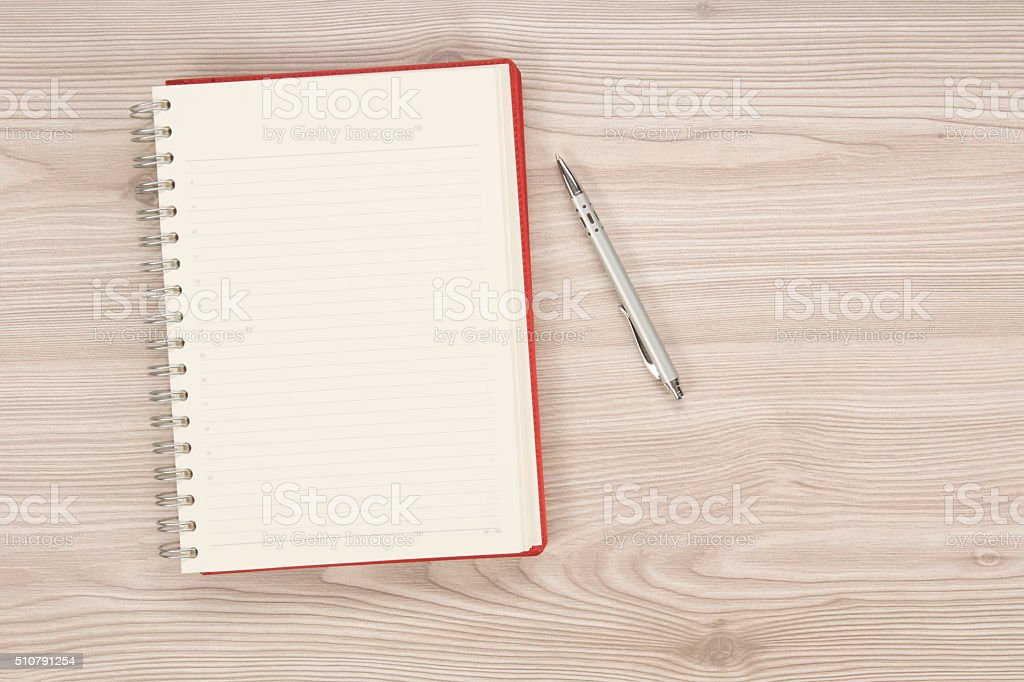 blank notebook on the table stock photo