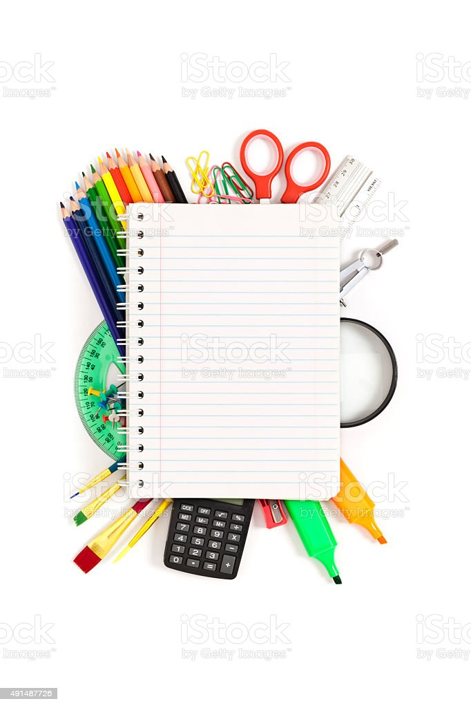 Blank notebook over colorful school supplies stock photo
