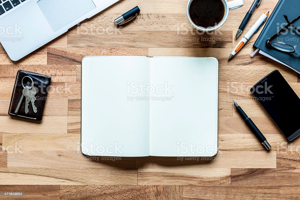 Blank Notebook Page on Desinger's Desk for Creative Brainstorming stock photo