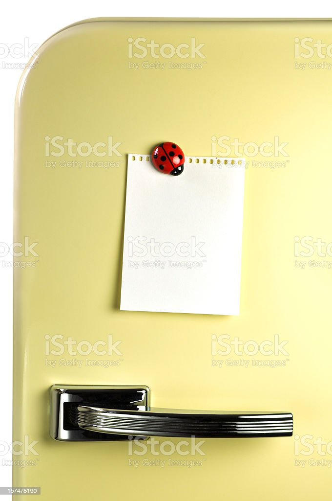 Blank notebook paper on fridge with magnet stock photo