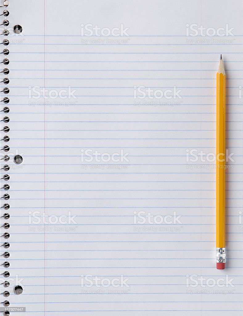 Blank notebook paper with pencil on side stock photo