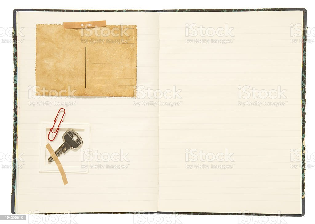 Blank notebook, postcard and key royalty-free stock photo