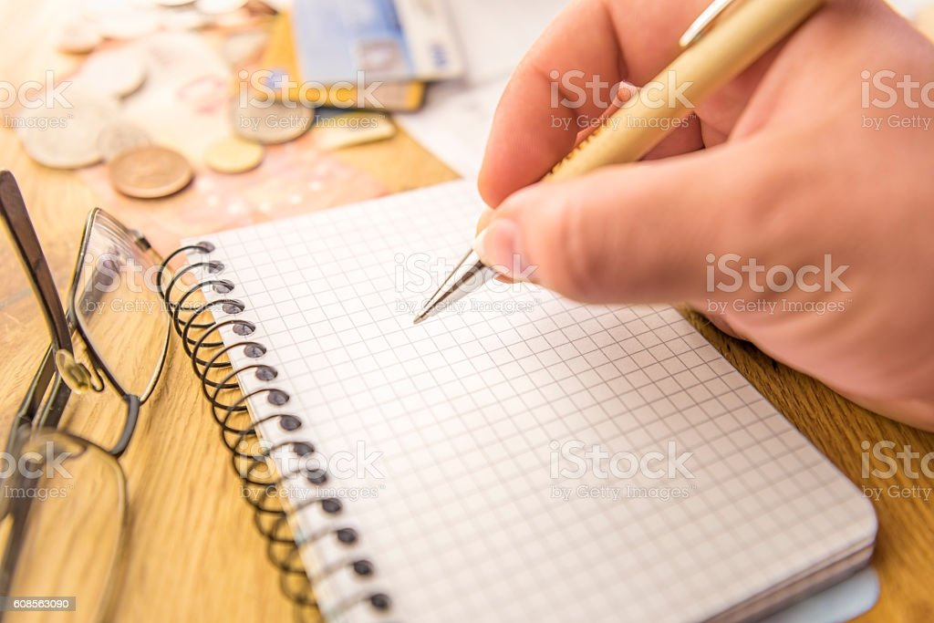 Blank notebook surrounded by financial elements stock photo