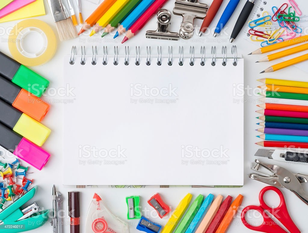 Blank notebook with colorful markers, pencils, and tools royalty-free stock photo