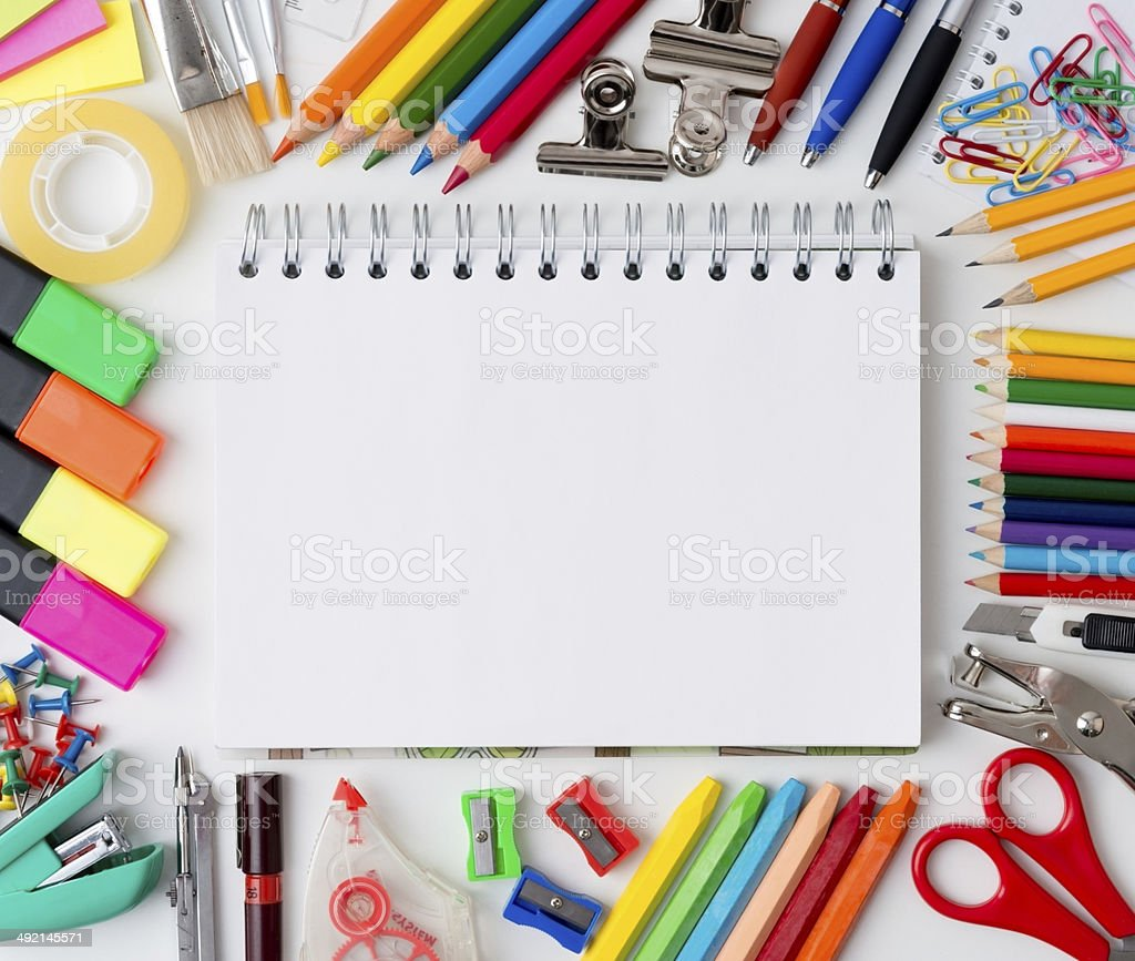 Blank notebook with colourful crayons stock photo