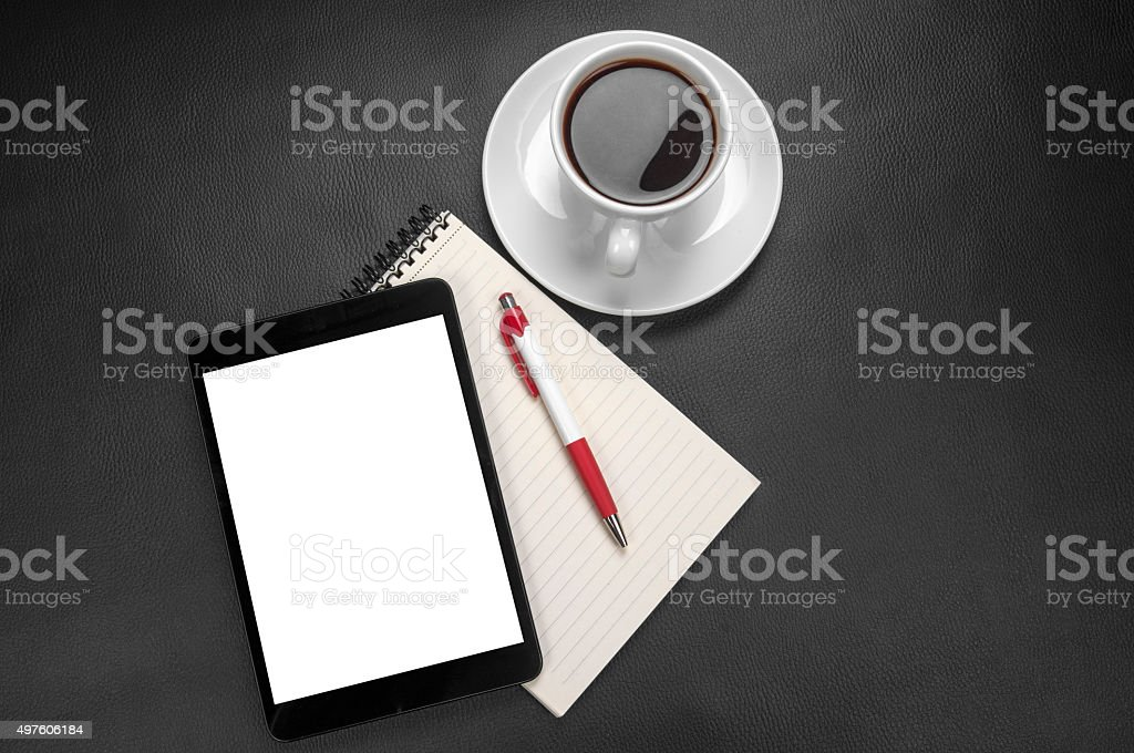 Blank notebook with mini tablet, pen and coffee stock photo